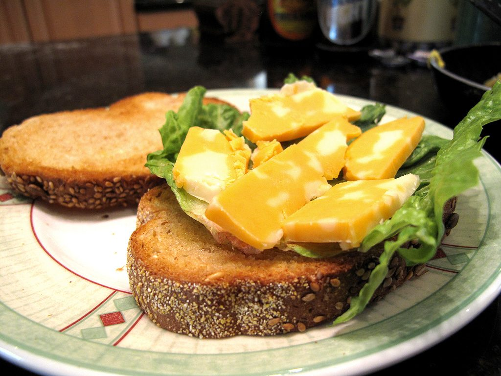 Line the toast with some lettuce, and cover with cheese