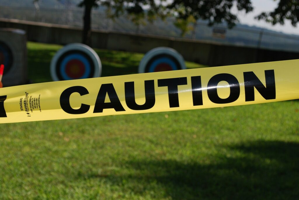 caution tape obstructs the background scenery