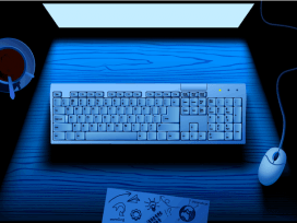 Computer keyboard on table illuminated by blue light of monitor screen Licensed Computer keyboard on table illuminated by blue light of monitor screen