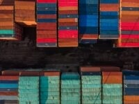 two rows of stacked shipping containers