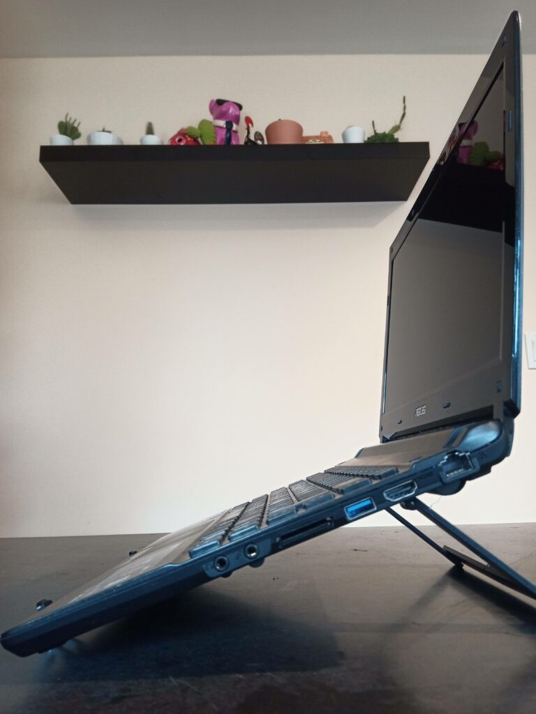 Side view of Mantiz stand with a laptop mounted upon it.